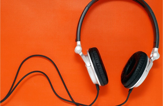 Headphones that can be used to listen to O.C. Tanner's online employee appreciation webinars