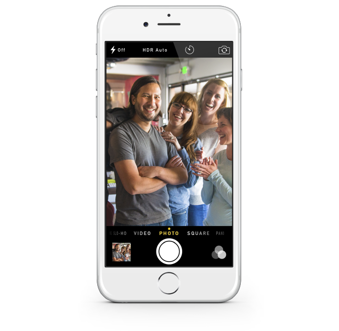 A mobile device with a photo of an employee service awards celebration |O.C. Tanner