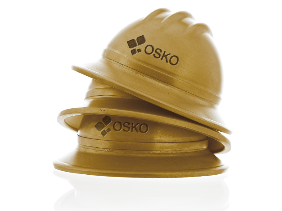 Image of custom made, branded, mini brass hard hats O.C. Tanner created for OSKO Energy's employees' years of service awards.